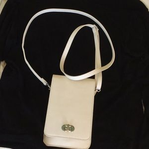 NWOT Ivory vegan bag with your cell on the back!